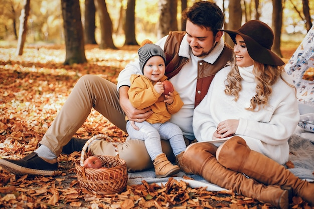 Beautiful and stylish family in a park Free Photo