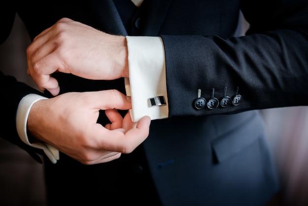 Beautiful stylish groom's cufflinks on the shirt Free Photo