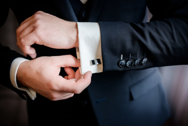 Beautiful stylish groom's cufflinks on the shirt Free Photo
