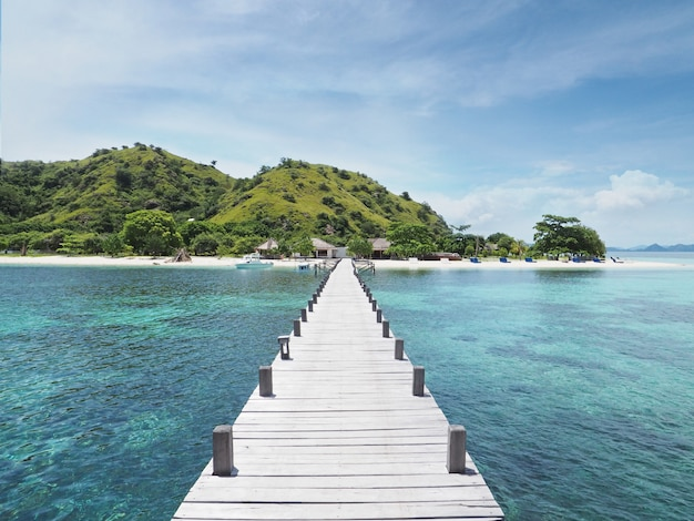 Beautiful summer view of wooden bridge to tropical island. Premium Photo