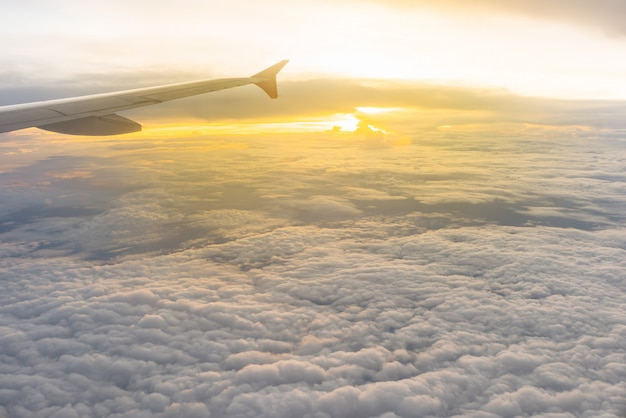 Beautiful sunlight and cloudy as seen through window of an airplane Premium Photo