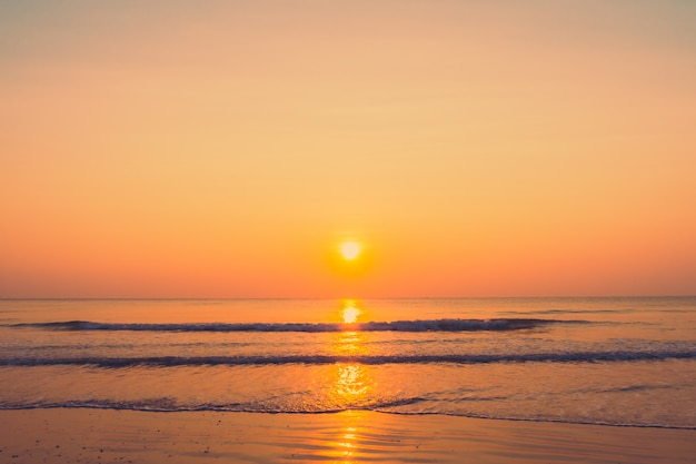 Beautiful sunrise on the beach Free Photo