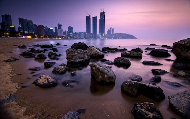 Beautiful sunrise at busan beach,busan, south korea. Premium Photo