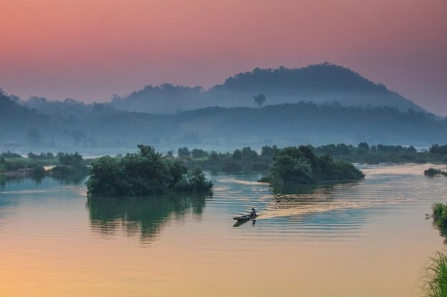 Premium Photo   Beautiful sunrise on mekong river, border of thailand and  laos, nongkhai province, thailand.