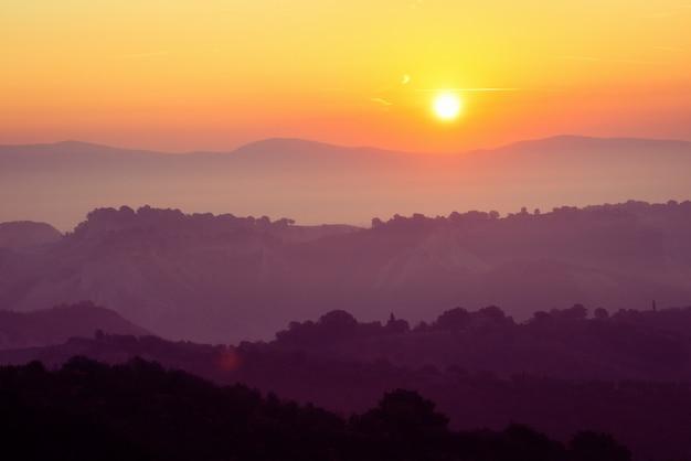 Beautiful sunrise at mountain landscape in summer. Premium Photo