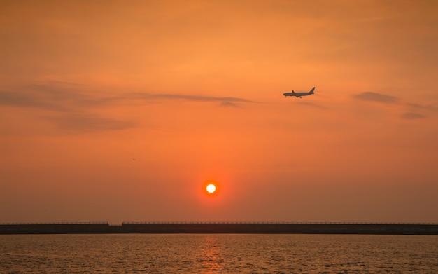 Beautiful sunset and airplane at jeju do island, south korea. Premium Photo
