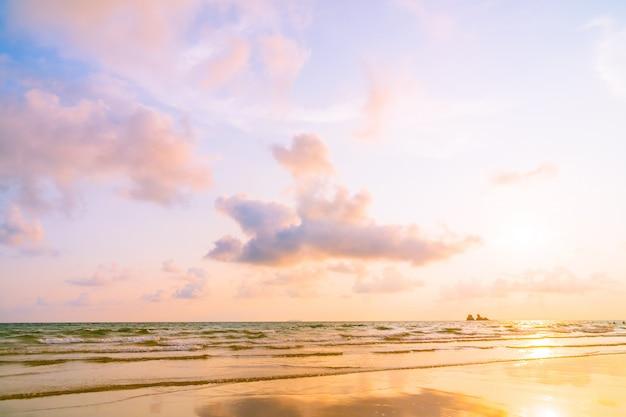 Beautiful sunset on the beach and sea Free Photo