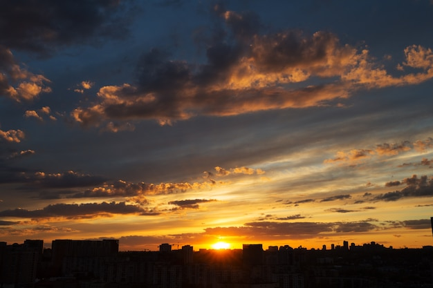 Beautiful sunset over big city with amazing clouds Free Photo