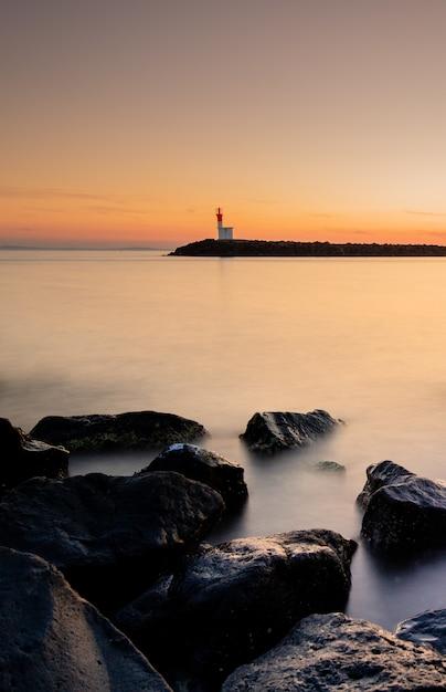 Beautiful sunset at a foggy port Free Photo