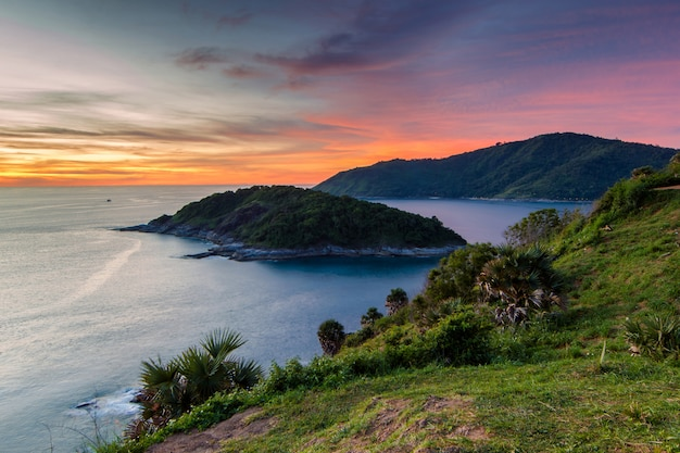 Beautiful sunset in promthep cape is a mountain of rock that extends into the sea in phuket Premium Photo