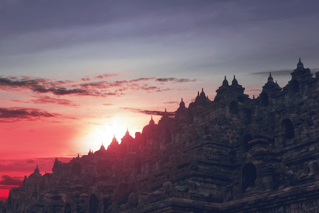 Beautiful sunset seen from top of borobudur temple Premium Photo