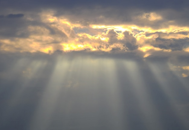 Beautiful sunset sky with amazing sun rays background Premium Photo