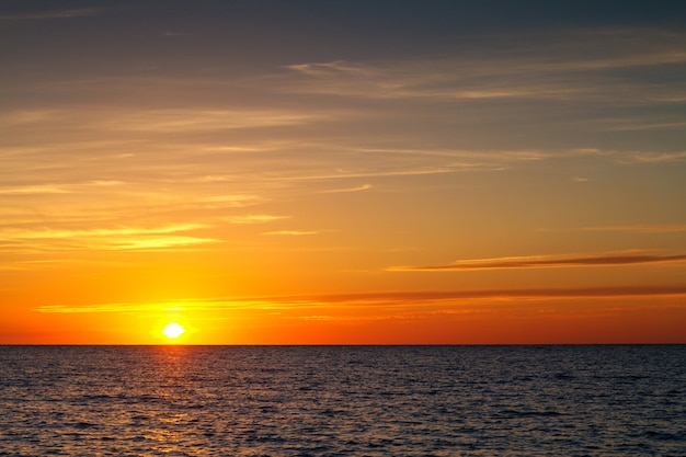 Beautiful sunset with clouds over the sea Premium Photo