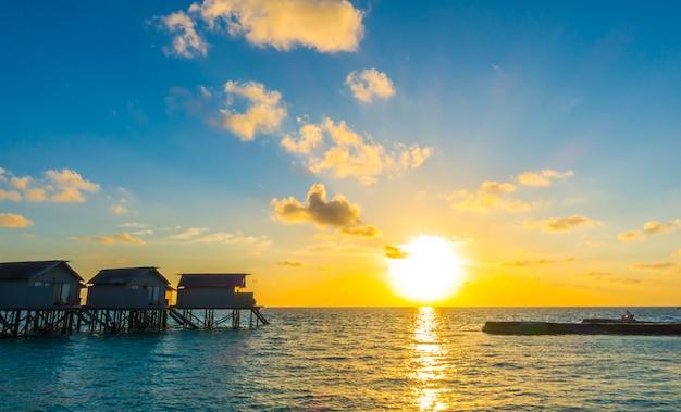 Beautiful sunset with  water villas  in tropical maldives island . Premium Photo