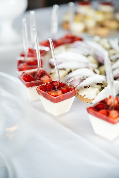 Beautiful sweets with strawberries for wedding celebration Free Photo