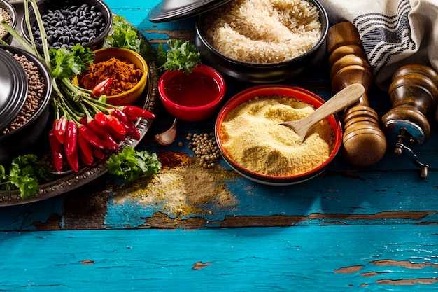 Beautiful tasty appetizing ingredients spices grocery for cooking healthy kitchen. blue old wooden background top view. Free Photo