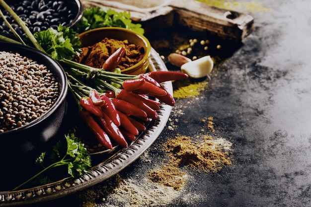 Beautiful tasty appetizing ingredients spices grocery for cooking healthy kitchen. dark black background horizontal toning copy space Free Photo