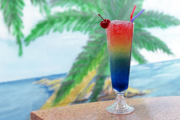 Beautiful tasty colorful drink cocktail in a glass with juice Premium Photo