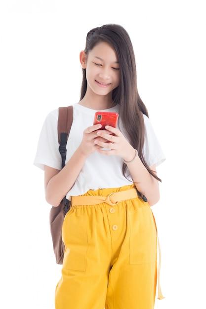 Beautiful teenage girl using smart phone isolated over white background Premium Photo