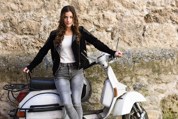 Beautiful teenager with a white scooter Free Photo