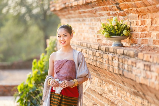 Beautiful thai girls in thai traditional costume at old temple, ayutthaya province, thailand Premium Photo