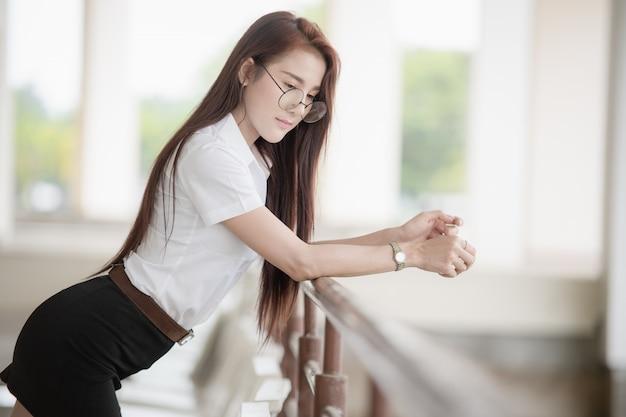 Beautiful thai university student wearing thai university student uniform. Premium Photo
