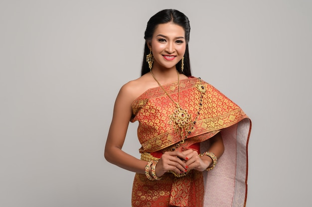 Beautiful thai woman wearing a thai dress and a happy smile. Free Photo
