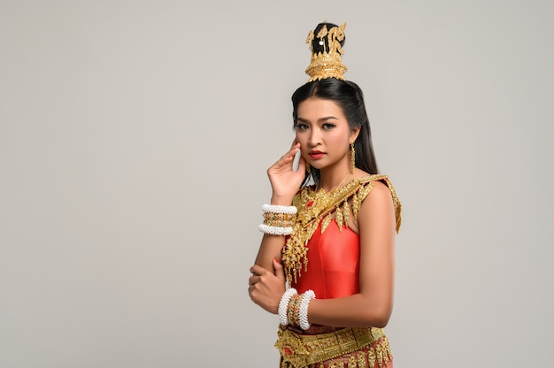 Beautiful thai woman wearing thai dress and looking to the side Free Photo