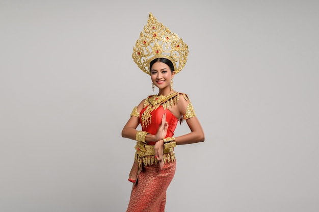 Beautiful thai woman wearing thai dress and thai dance Free Photo