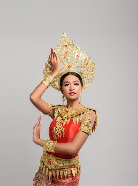 Beautiful thai woman wearing thai dress and thai dance Free Photo