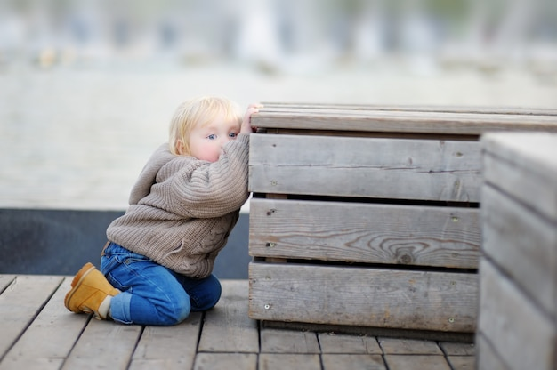 Beautiful toddler boy playing outdoors at the spring or summer day Premium Photo