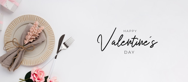 Beautiful top view table setting for valentines on white Free Photo