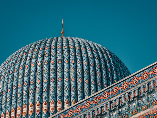 Beautiful tower of the mosque against the blue sky Premium Photo