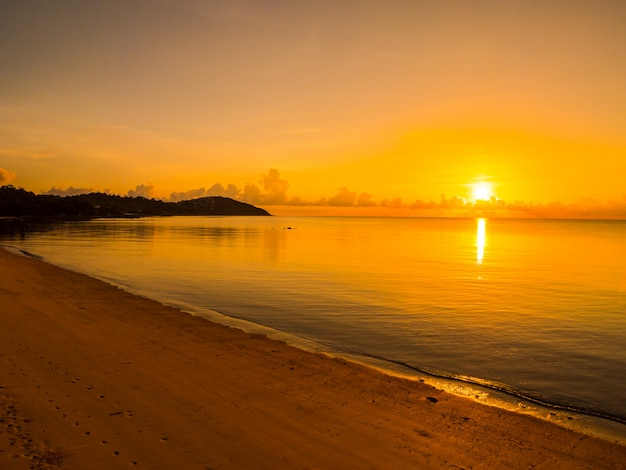 Beautiful tropical beach and sea ocean landscape with cloud and sky at sunrise or sunset time Free Photo
