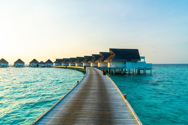 Beautiful Tropical Sunset Over Maldives Island With Water
