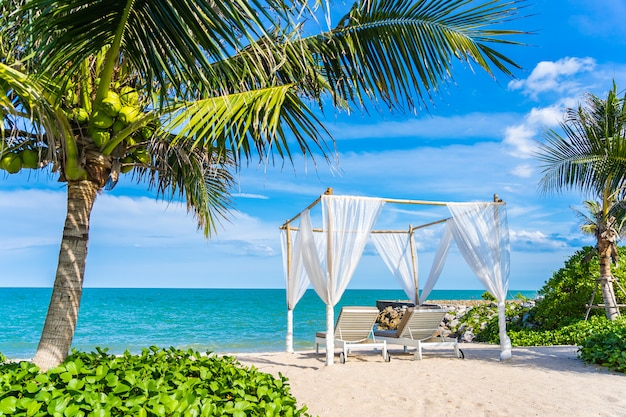 Beautiful umbrella and chair around beach sea ocean with blue sky for travel Free Photo