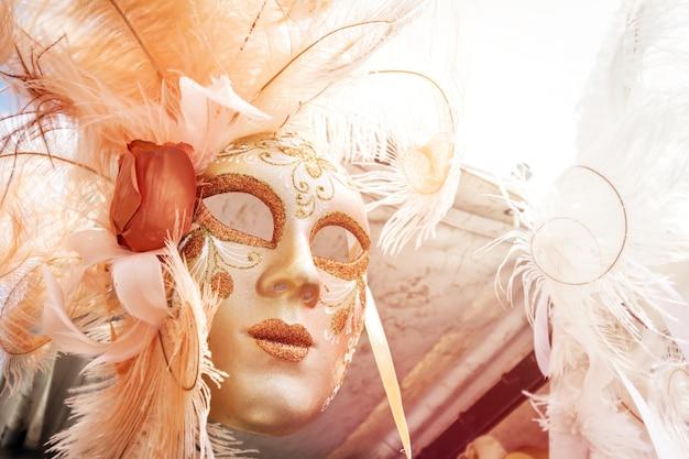 Beautiful venetian mask hanging for sale. sunlight, day light. toning. horizontal. Free Photo