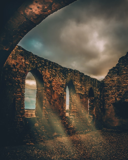 Beautiful vertical shot of a stone medieval viaduct Free Photo