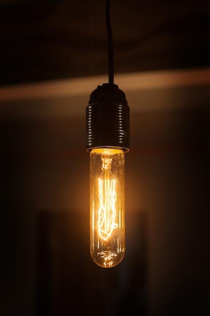 Beautiful vintage lamp shines in the room Premium Photo