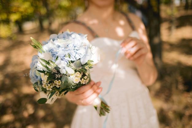 Beautiful wedding bouquet of flowers in bride's hands Premium Photo