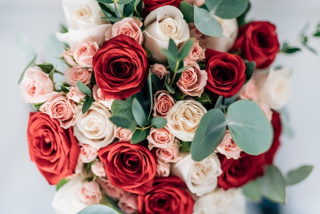 Beautiful wedding bouquet of roses Free Photo