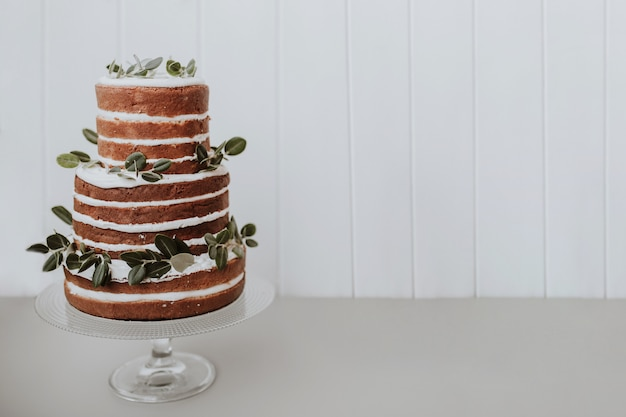 Beautiful wedding cake on white background with space to the right Free Photo