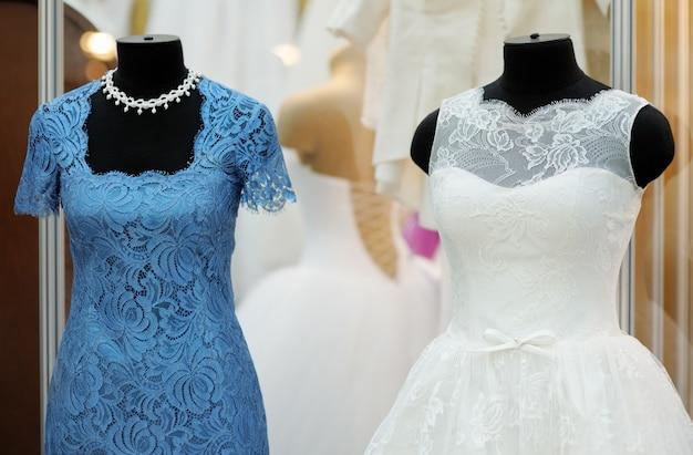 Beautiful wedding dresses on a mannequin indoors Premium Photo