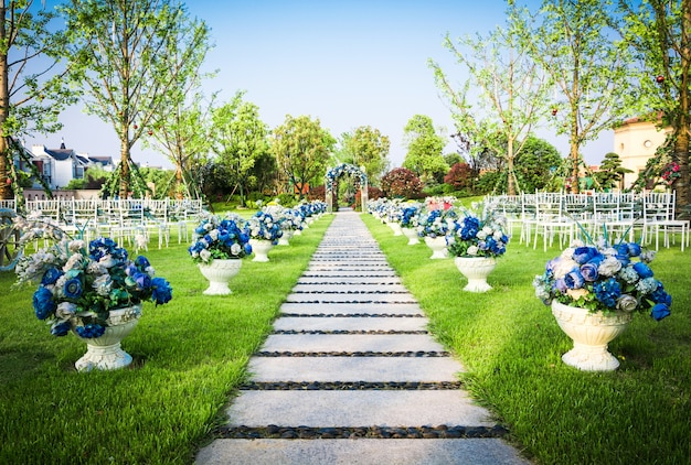 Beautiful wedding flower arrangement of seats along the aisle Free Photo