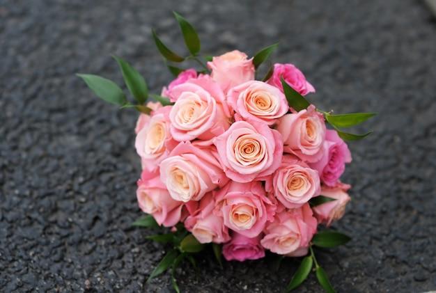 Beautiful wedding flowers bouquet (made of roses) on dark Premium Photo