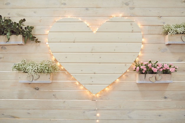 Beautiful wedding heart decor for photographing in rustic style. Premium Photo
