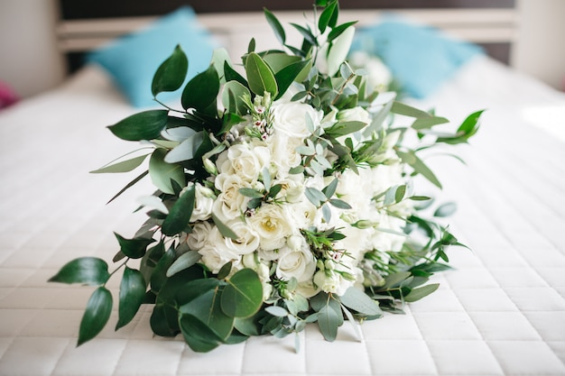Beautiful white flowers lie on the table Free Photo
