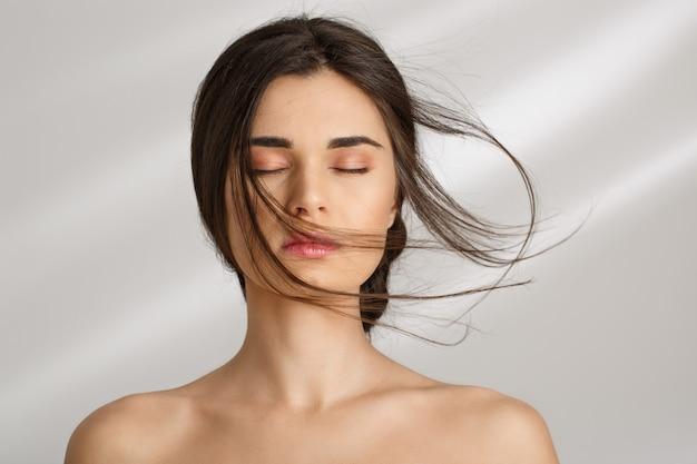Beautiful woman after spa procedures enjoying herself. eyes closed. Free Photo