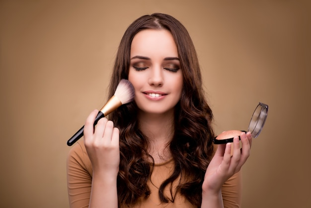 Beautiful woman applying make-up in beauty concept Premium Photo