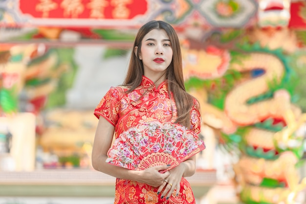 Beautiful woman asian wearing red dress in chinese new year Premium Photo